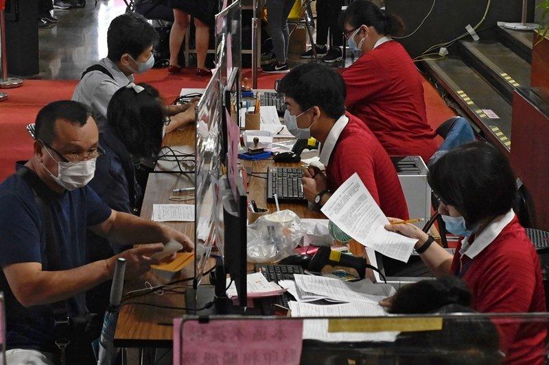 該文研究員對台灣相關法律「早已完備」的理解是有問題的。 圖/法新社