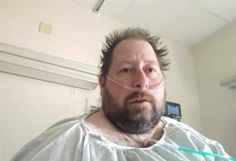 男子稱疫情為「假危機」,他與妻子染病毒掛呼吸器。圖/世界日報提供