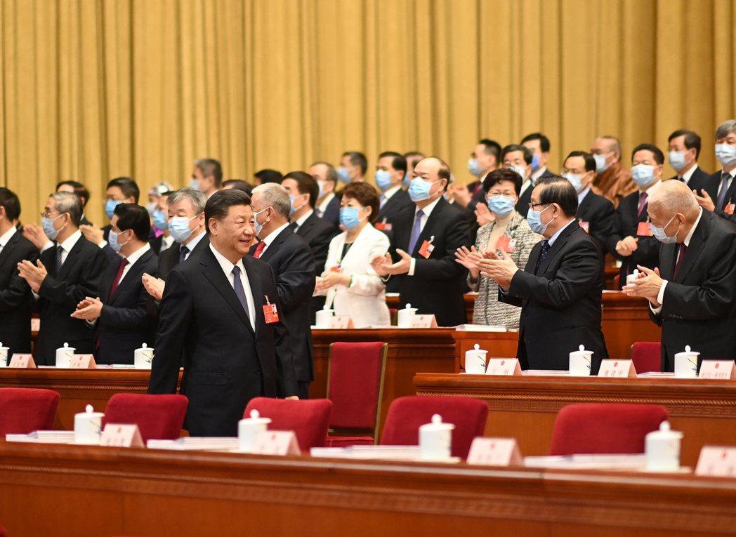 5月22日,第十三屆全國人民代表大會第三次會議在北京人民大會堂開幕。 圖/新華社