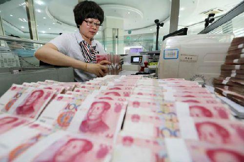 人民幣中間價今(26)日報7.1293,下調84點,貶值至2008年2月28日以來新低。照片/新華社