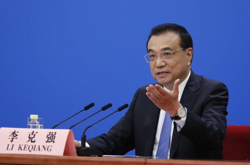 大陸總理李克強昨在年度記者會重申,堅持一個中國原則、反對台獨。(中新社)