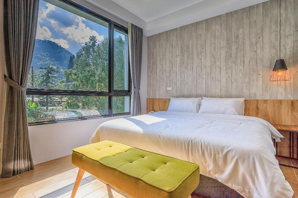 嘎巴暮暮會館結合邵族元素打造清爽簡約風格的民宿。 圖/Agoda提供