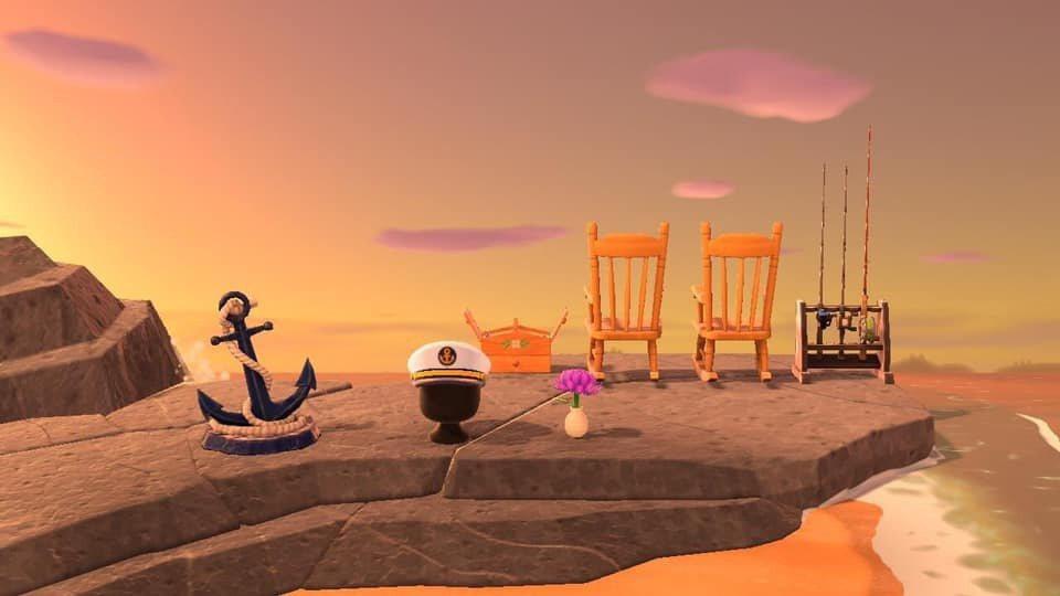 有玩家為了緬懷爺爺奶奶,在遊戲中打造了兩張面向大海的搖椅,以及象徵海軍的船錨和軍...