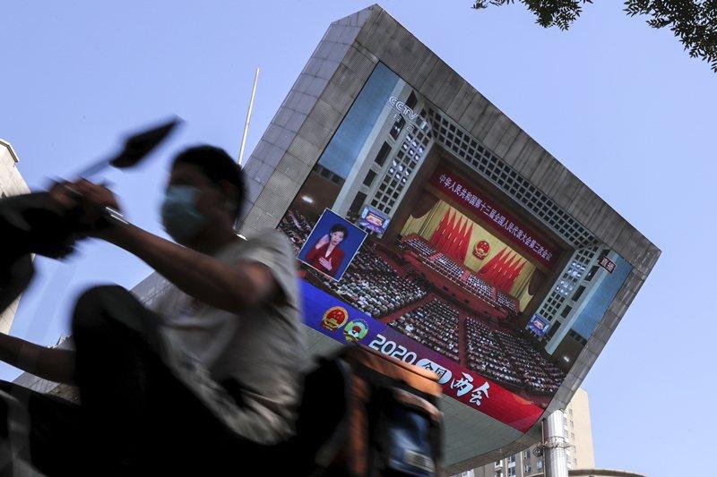 第3條關於香港制度五十年不變的承諾,仍舊在2047年之前拘束著條約當事國的中國。 圖/美聯社