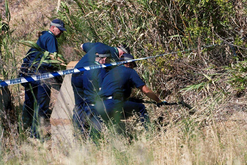 2014年在案發地點附近的搜查人員。 圖/路透社