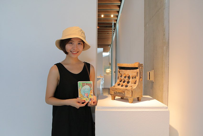 民眾參加導覽時,分享自己天馬行空想像小島的故事,就能獲得阿咧插畫明信片或徐橘喵的...