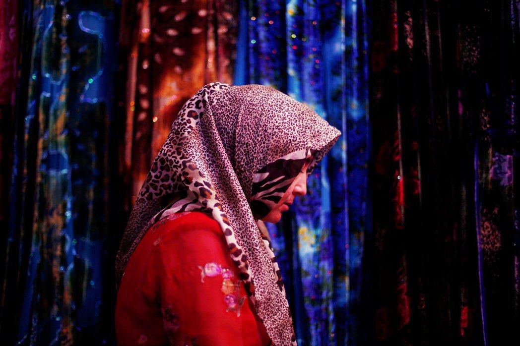 圖為2009年在新疆和田禱告的婦女。 圖/美聯社