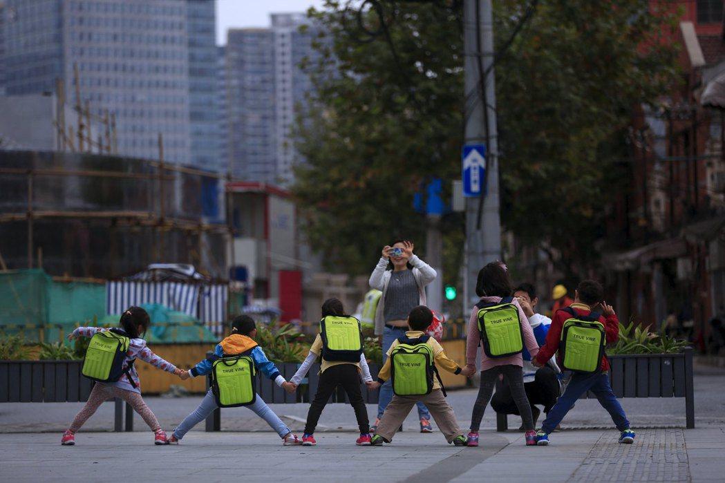「假如這附近沒有地方可以給你們住的話,我們幼稚園早晚也會倒閉的。」 圖/路透社