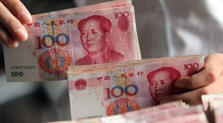 中國人民銀行近日公告,自2020年7月起,個人存取人民幣10萬以上要辦理登記,河北省的金融系統先試點。照片/新華網