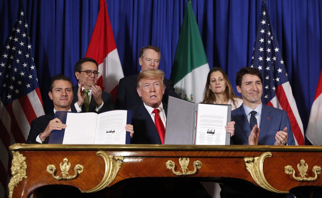 由美國、加拿大及墨西哥簽訂的新版北美自由貿易協定(USMAC)將於明日上路。(美...