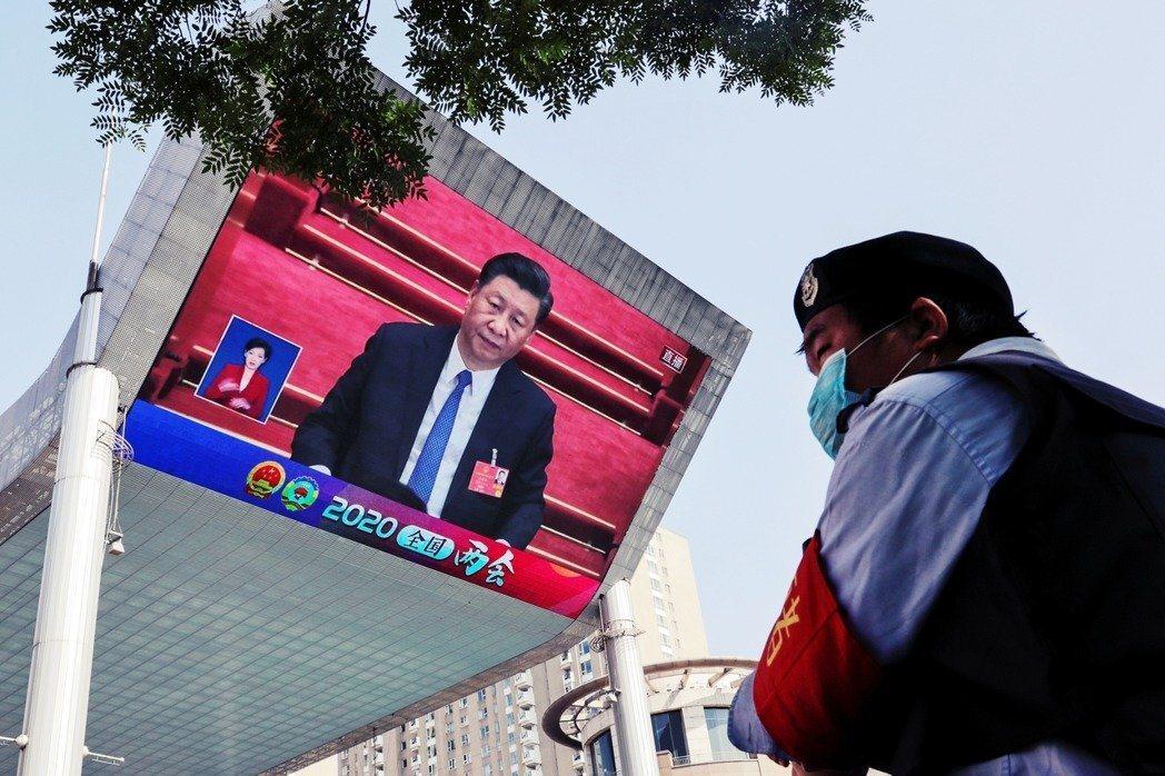 中國兩會上習近平的新聞畫面。 圖/美聯社