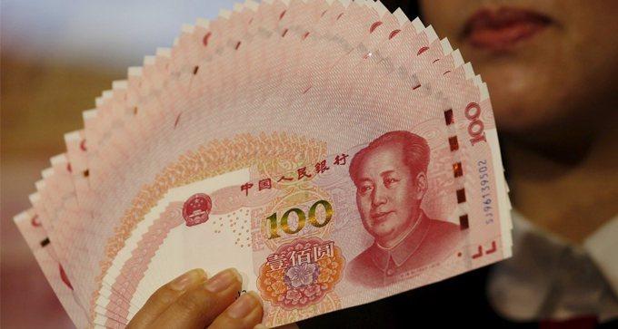 中國央行搶先推行數位人民幣,看在我國央行眼中,其實有著「不想說的秘密」。本報資料...
