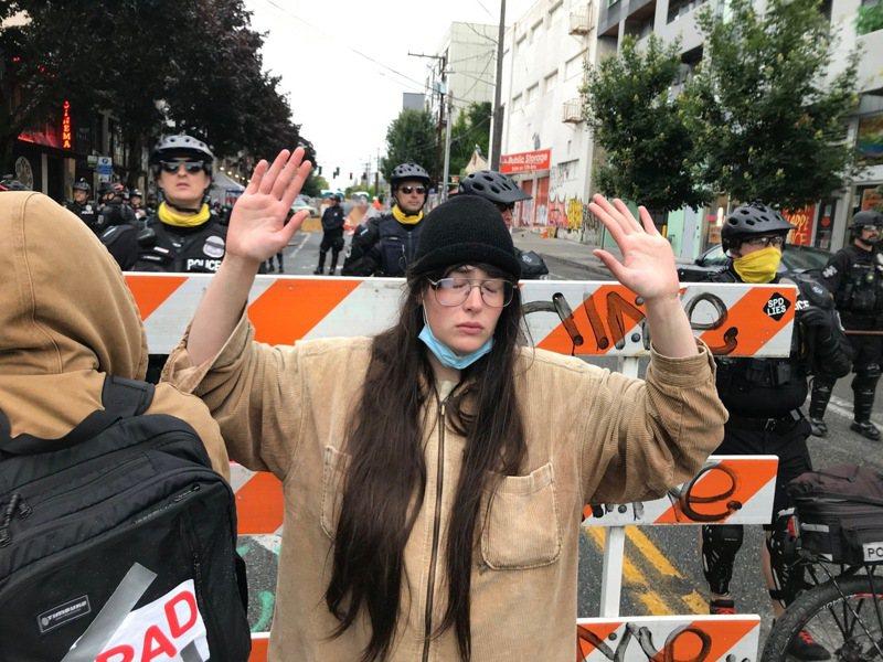 西雅圖淨空自治區,十餘人被捕。 美聯社