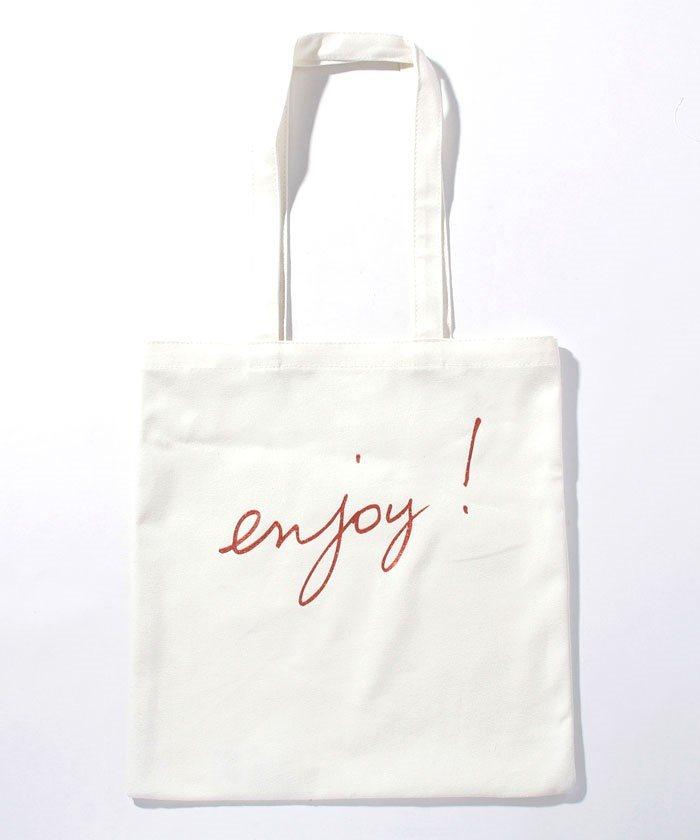 白色手寫標語帆布包,1,980元。圖/agnès b.提供