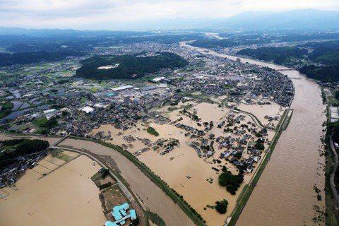 圖為熊本縣水災空拍畫面。 圖/歐新社