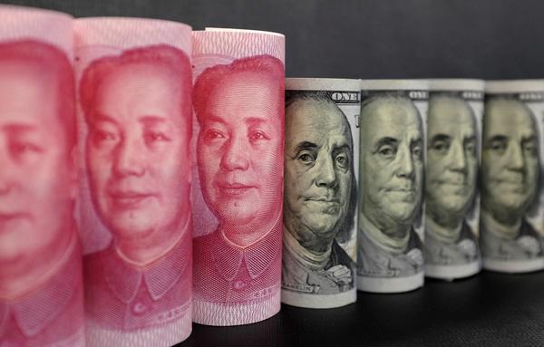 今(9)日人民幣兌美元中間價升值122個基點,報7.0085,創近四個月以來新高。路透資料照片