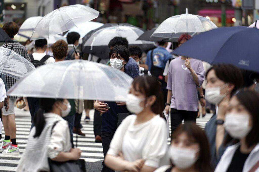東京新增確診數已連續3天飆破200例。 圖/美聯社