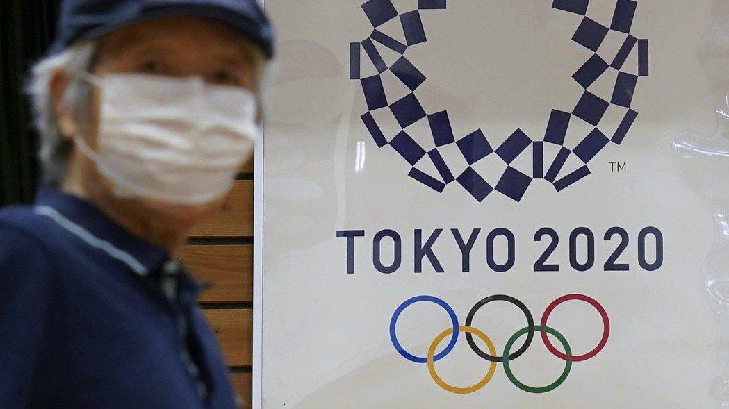 今年夏季奧運會原定在本月舉行,但因為疫情被迫延至明年開賽。 歐新社