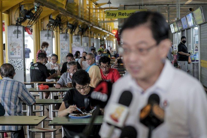 如同許多國家的民主選舉,新加坡許多值得深入討論的社會議題在尚未展開前,就被政治口水戰淹沒。 圖/歐新社