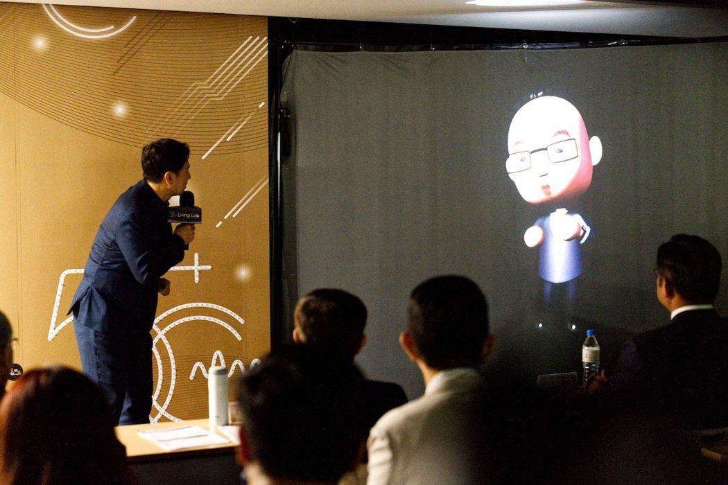 Q版3D虛擬工業局呂正華局長與真人當場互動,凸顯5G高速傳輸能力。 經濟部工業局...