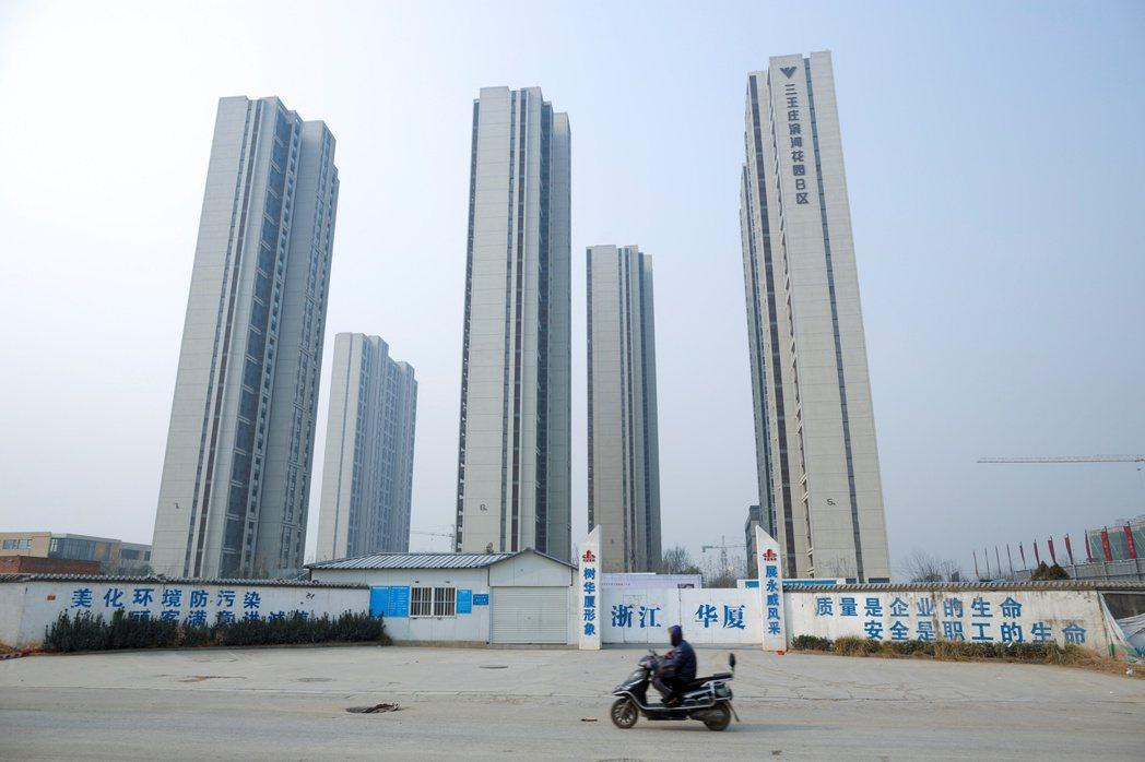 有土斯有財,是許多中國人根深柢固的觀念。  路透