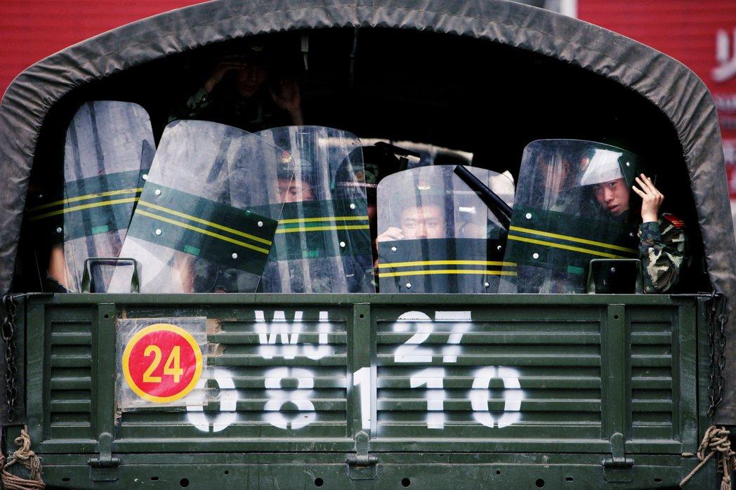 圖為資料圖片,駐新疆中國武警。 圖/路透社