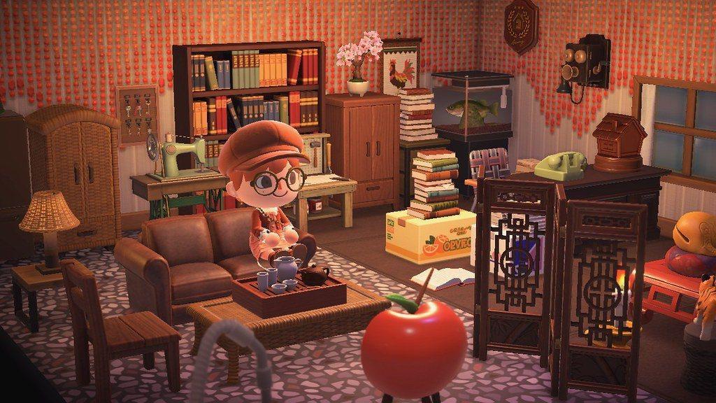 懷舊客廳的主角是垂簾牆和自己畫的洗石子地板,此外也可以看到阿波如何把魚缸和公雞掛...