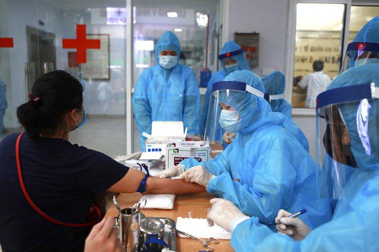 越南疫情捲土重來。 圖/美聯社