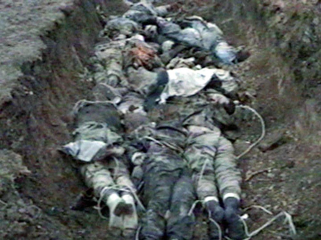 圖為車臣戰爭的非法處決。 圖/路透社