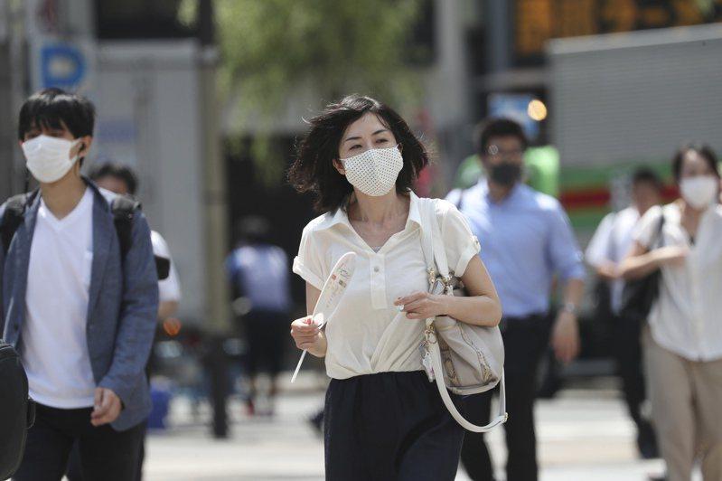 日本境內昨新增1240例確診病例。 美聯社