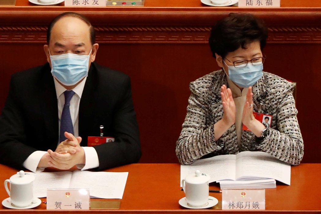 在北京開人大、見證並護航港版國安法通過的林鄭月娥。 圖/路透社