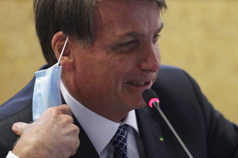 巴西確診死亡人數破10萬,總統波索納洛消極、以經濟優先的態度會是主要原因。 美聯社