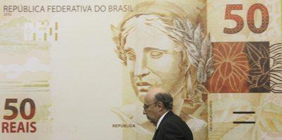 巴西里爾匯率重貶,導致投資巴西公債的南韓散戶面臨巨大虧損。  路透