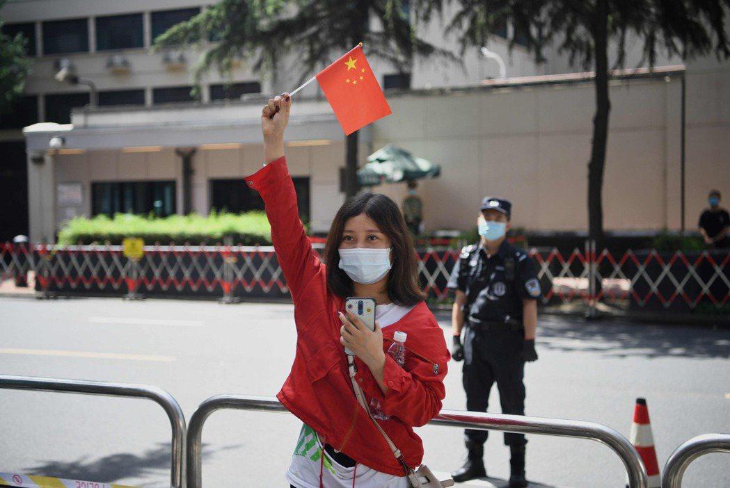 相較於美國加強針對中國的一連串執法行動,足見台灣政府的乖順。 圖/法新社