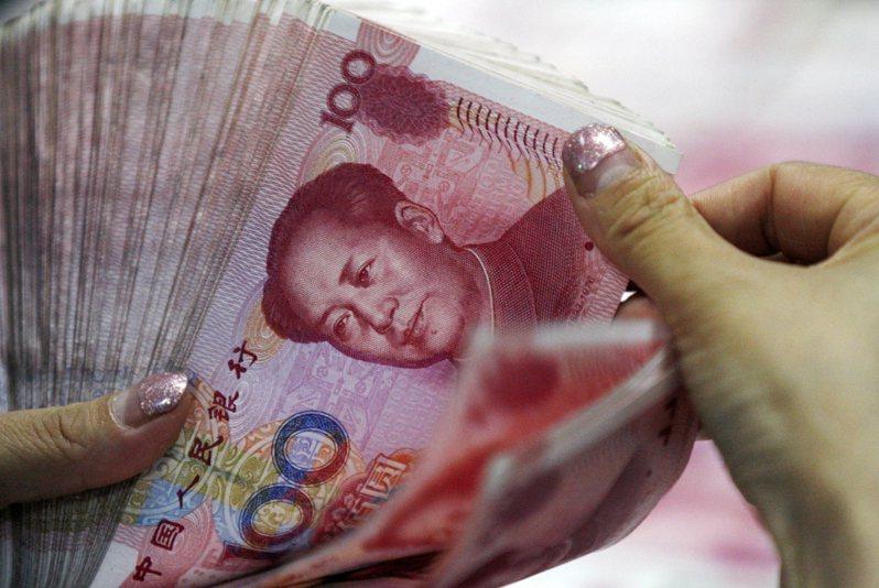 中國人民銀行最新公布的報告顯示,人民幣國際化程度不斷提升。美聯社