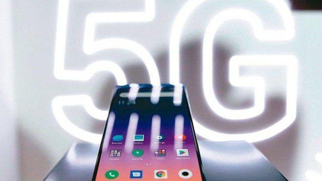 5G高速/低延遲/大連結特性,也成為此次智慧防疫的推手之一。 報系資料照