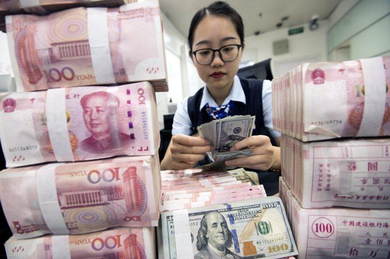 中共再度宣傳數位人民幣擴大試點,由於涉及諸多技術難題,其中虛實引起多方揣測。 圖/歐新社