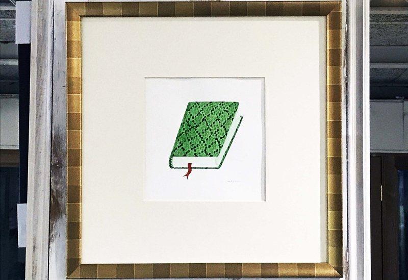 智海將自身的存在象徵(生肖屬蛇,喜歡書)畫成了一本露出布條書簽正在吐信的蛇皮書。 圖/作者提供