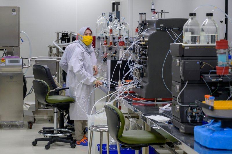 中國科興生物已與印尼國有藥商Bio Farma合作開發,並計畫募集1千多人進行疫苗測試。 圖/法新社