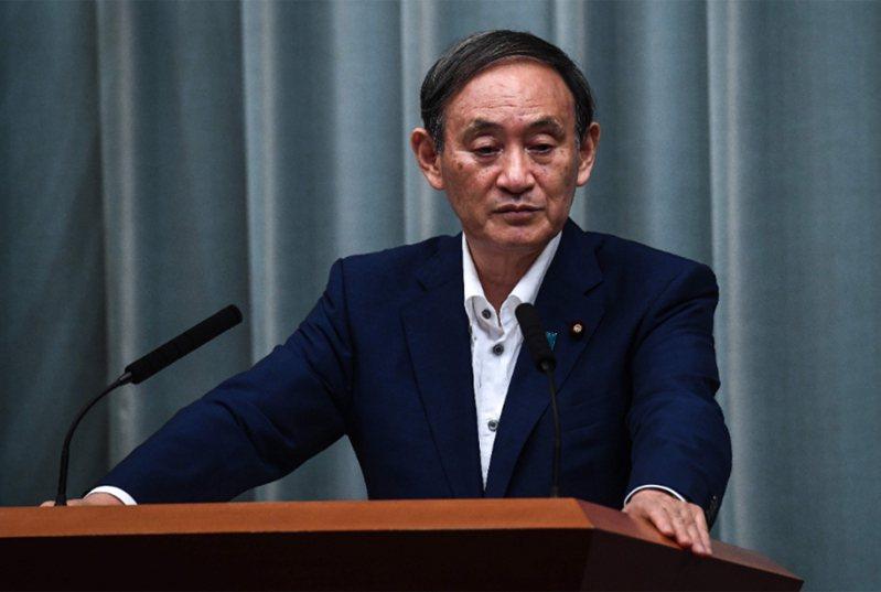 日本內閣官房長官菅義偉卅一日在東京召開記者會。法新社