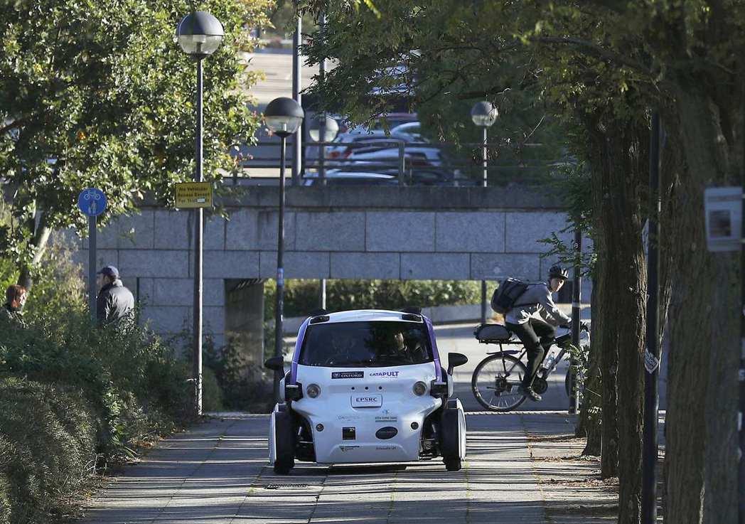叫車軟體與無人駕駛車輛能為城市解決什麼舊問題?帶來什麼新改變? 圖/路透社