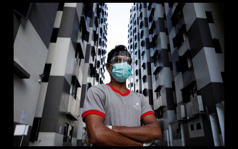 新加坡外籍移工。路透