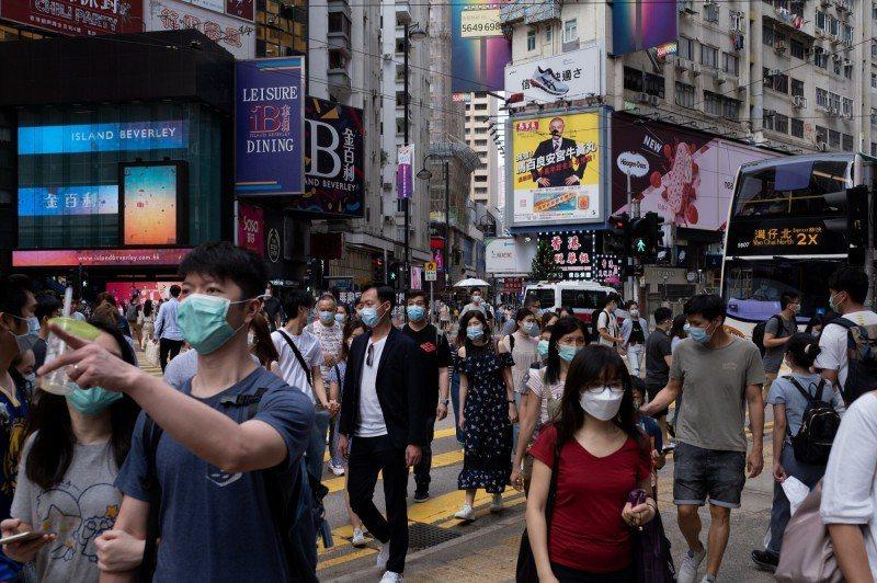 香港疫情未止。圖/取自彭博