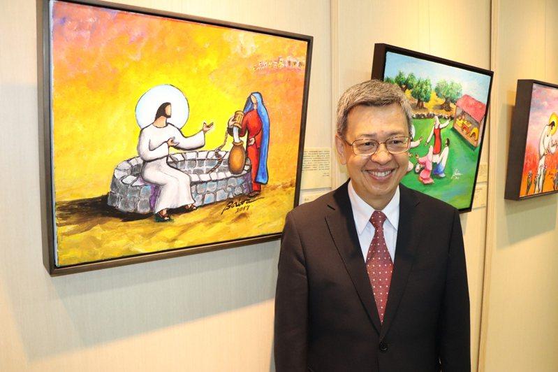 前副總統陳建仁與畫作「活水」合影。記者吳亮賢/攝影