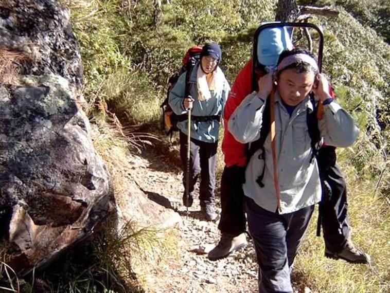 一般遊客來到高海拔的山區,要注意做好高度及體能適應,否則極易發生急性高山症。圖/...
