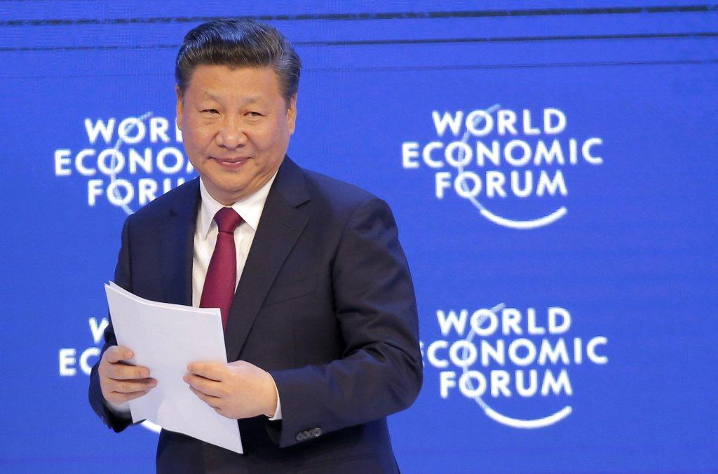 習近平在2017年初的達佛斯世界經濟論壇中,對世界經濟領袖喊話,要建構「人類命運共同體」。 圖/美聯社