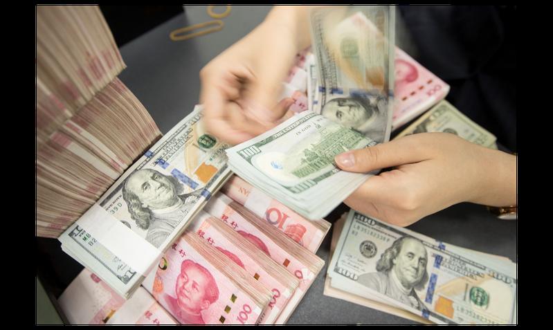 今年6月以來人民幣就持續走強,但有學者警告,人民幣恐面臨貶值修正的壓力。法新社