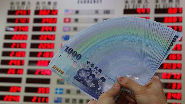 新台幣。 報系資料照