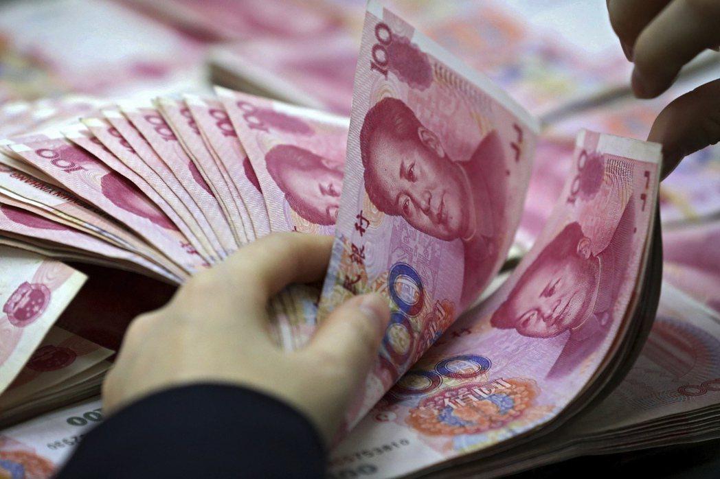 人民幣對美元匯率21日創下兩年多來新高。美聯社