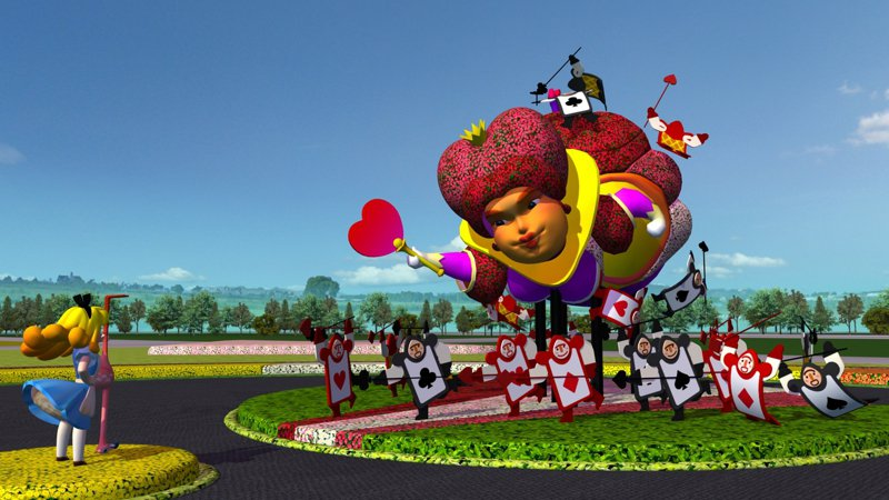 台中國際花毯節主花毯「勇氣之心」,高10公尺的紅心皇后由一群撲克牌士兵簇擁著,居高臨下朝著愛麗絲飛來,呈現愛麗絲勇敢對抗皇后的情節。圖/台中市府觀旅局提供